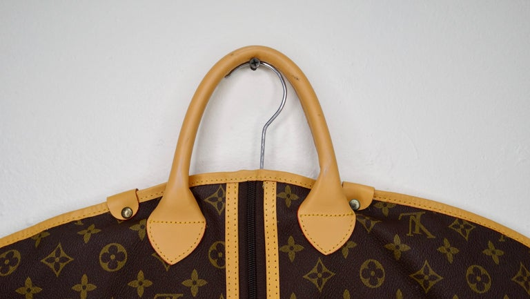 Travel in style with this amazing vintage Louis Vuitton garment bag! Circa late 20th-century, this stylish garment bag carrier is crafted from Louis Vuitton's iconic two-tone monogram on toile canvas. Features a leather trim, an LV long zipper up