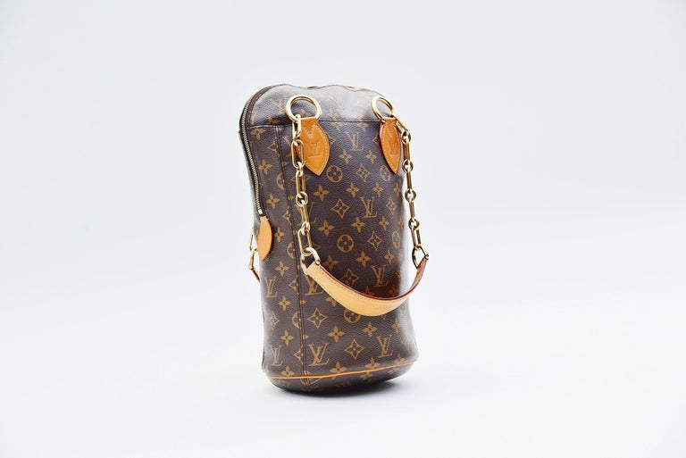 From the collection of Savineti we offer this Louis Vuitton Iconoclast Punching Bag: -	Brand: Louis Vuitton -	Model: Iconoclast Punching Bag (Karl Lagerfeld) -	Year: 2014 -	Serial Number: RI4124 -	Condition: Good -	Materials: Canvas, Leather,
