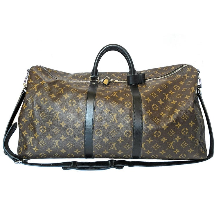 Spacious and flexible. Durable and dependable. Stylish and sophisticated. With its secure double zip and padlock, this is the perfect bag for business or pleasure. Retail $2,100.  Designer: Louis Vuitton Material: Monogram Macassar coated-canvas and