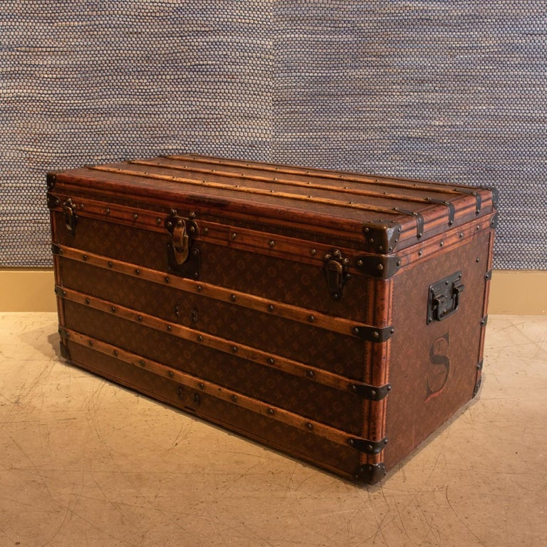 A lovely Louis Vuitton steamer trunk in monogram canvas with leather trim, patinated brass handles and fittings and original interior; minus the original trays, circa 1905.  Louis Vuitton was founded by its namesake in 1854, with the first shop on