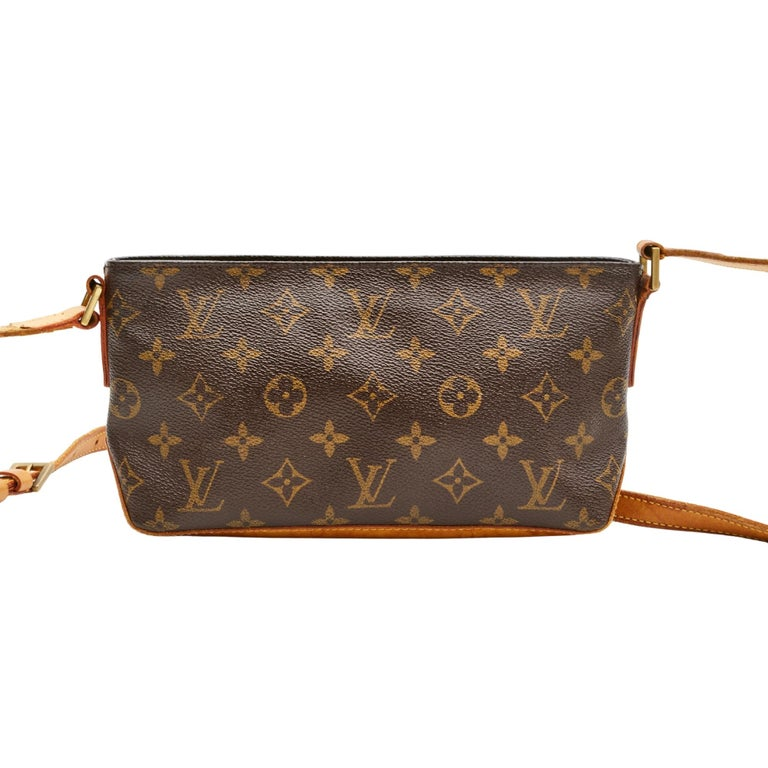 This shoulder bag is made with brown coated canvas with Louis Vuitton signature monogram print. The bag features beautifully aged light caramel natural cowhide leather finishes, top zip closure and a brown woven fabric interior.  COLOR: