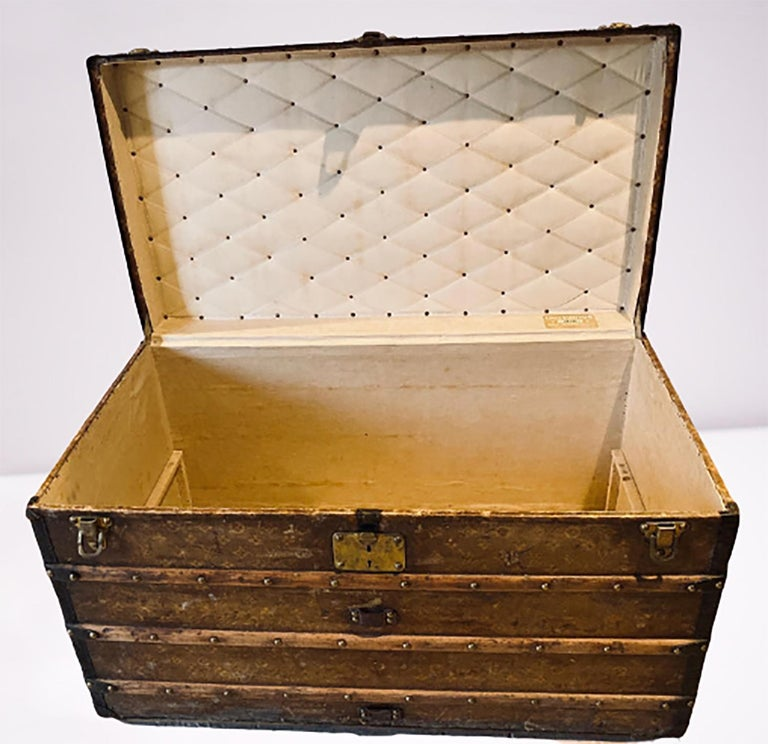Louis Vuitton Monograph steamer trunk. This finely constructed steamer trunk is still strong and sturdy as it seems to have traveled the world. This 1905 early steamer has it original rollers on the base as well as all of the original hardware. A