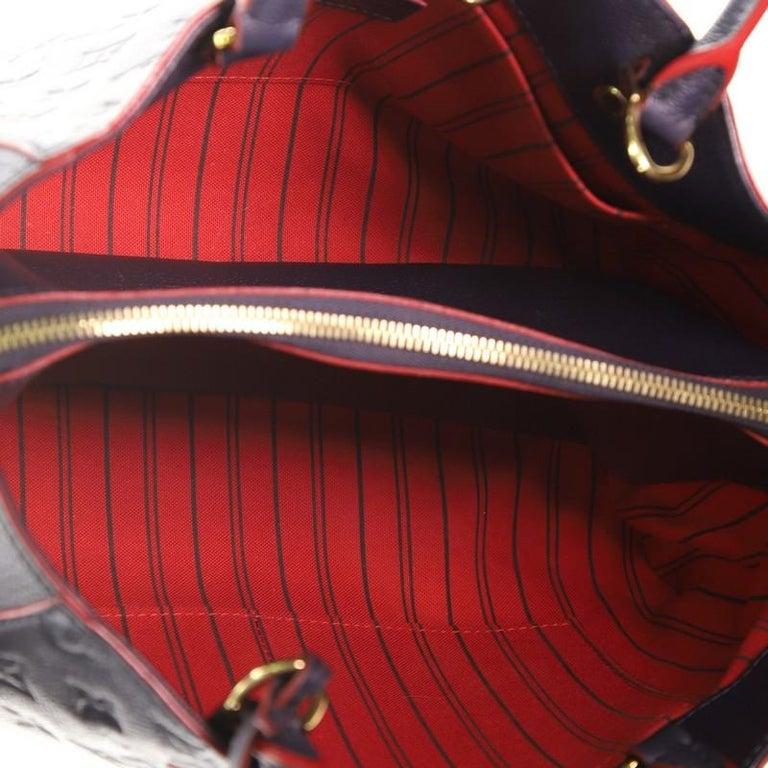 Women's or Men's Louis Vuitton Montaigne Handbag Monogram Empreinte Leather MM For Sale