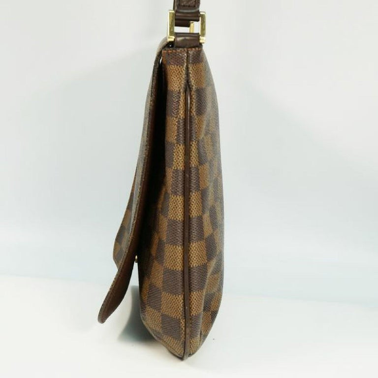 An authentic LOUIS VUITTON Musette Salsa shorts Womens shoulder bag N51260 Damier ebene. The color is Damier ebene. The outside material is Damier canvas. The pattern is Musette Salsa  shorts. This item is Contemporary. The year of manufacture would