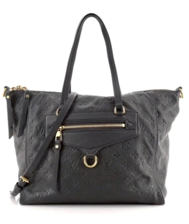 Louis Vuitton Black Empreinte Leather Lumineuse PM Bag We guarantee this is an authentic LOUIS VUITTON Empreinte Lumineuse PM or 100% of your money back. This stylish tote is crafted of Louis Vuitton monogram embossed leather in dark blue and