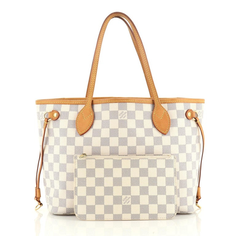 This Louis Vuitton Neverfull NM Tote Damier PM, crafted in damier azur coated canvas, features dual slim handles, side laces, and gold-tone hardware. Its wide open top showcases a white fabric interior with side zip pocket. Authenticity code reads: