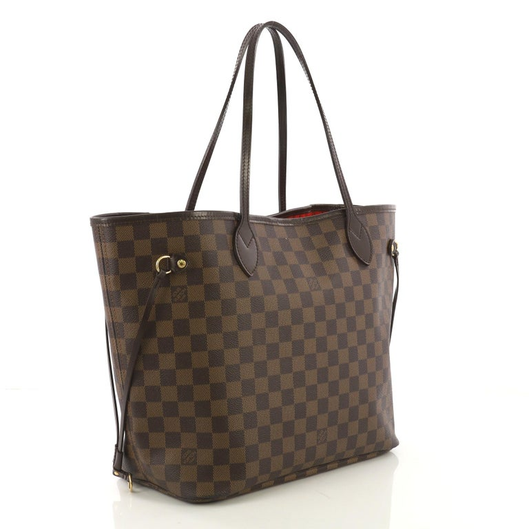 8398d6b31 This Louis Vuitton Neverfull Tote Damier MM, crafted in damier ebene coated  canvas, features