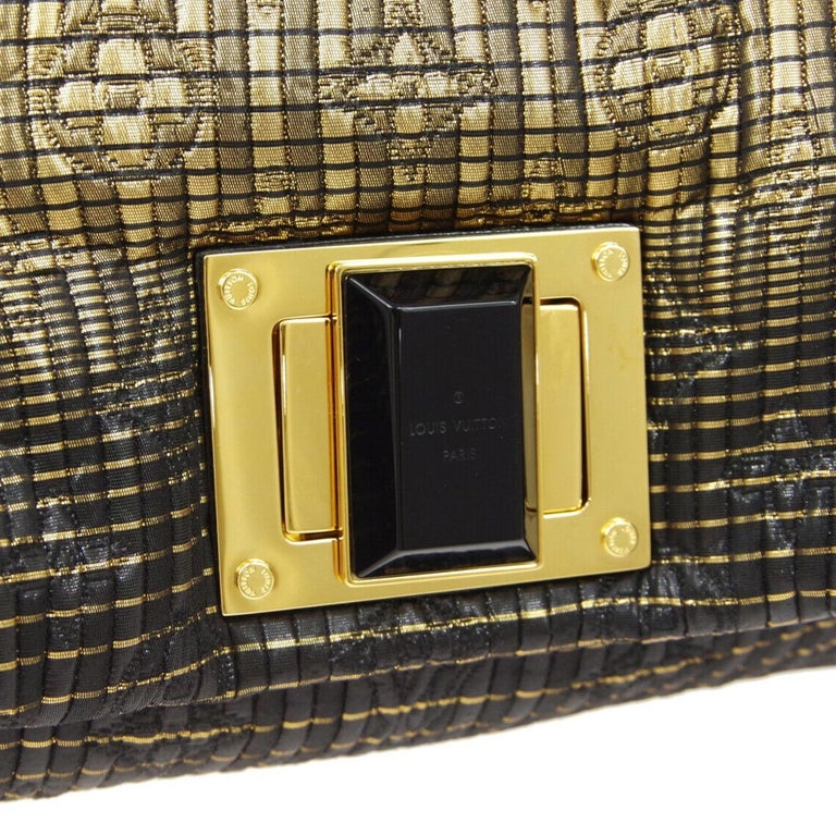 Leather Gold tone hardware Turnlock closure Woven lining Made in Italy Measures 10.5
