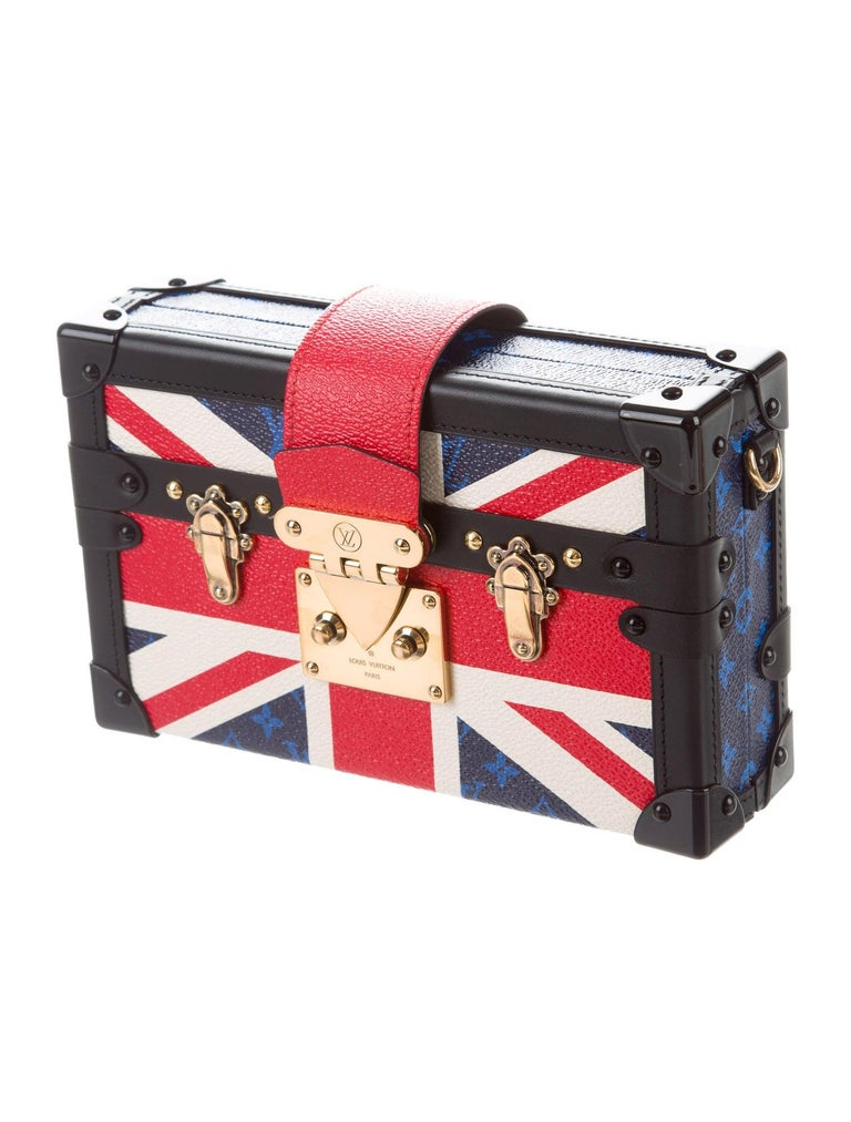 Extremely rare and limited edition, this Louis Vuitton clutch was created to commemorate the wedding of Prince Harry and Meghan Markle. Featuring the signature British Union Jack and brass-tone hardware, it is a one-of-a-kind historical piece that