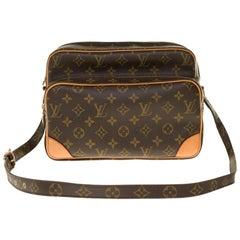 Louis Vuitton Nile Messenger shoulder bag in brown monogram canvas