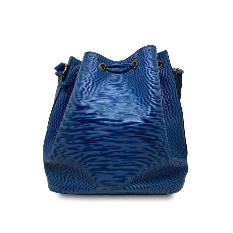 Vintage Louis Vuitton Noe PM Bucket Bag in Toledo Blue EPI Leather, September 1992. Made in France, the Noe was originally designed by Louis Vuitton's grandson in 1932 as a bag to carry champagne, specifically four bottles upright and one inverted