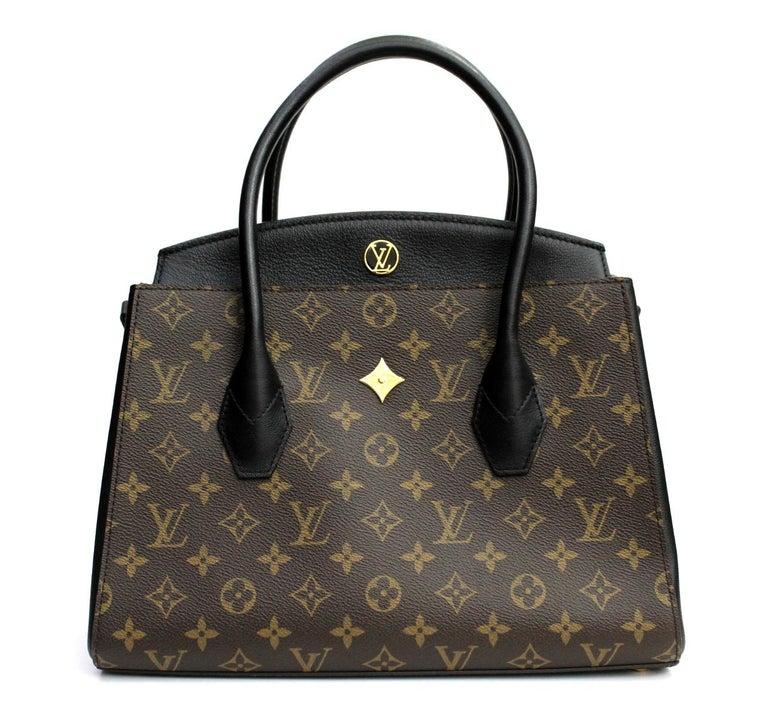 aa7e429558c LOUIS VUITTON Noir Monogram Canvas Florine Bag. It features the Monogram  canvas with black calf
