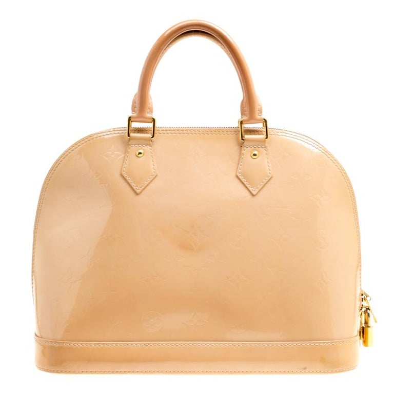 A classic from the house of Louis Vuitton, the shape of the Alma stands out. Louis Vuitton Alma was named after the Alma Bridge that connects Paris's fashionable neighborhood. The bag is made from signature Monogram Vernis that was introduced in