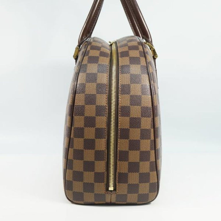 An authentic LOUIS VUITTON Nolita Womens Boston bag N41455 Damier ebene. The color is Damier ebene. The outside material is Damier canvas. The pattern is Nolita. This item is Contemporary. The year of manufacture would be 2004. Rank AB signs of wear