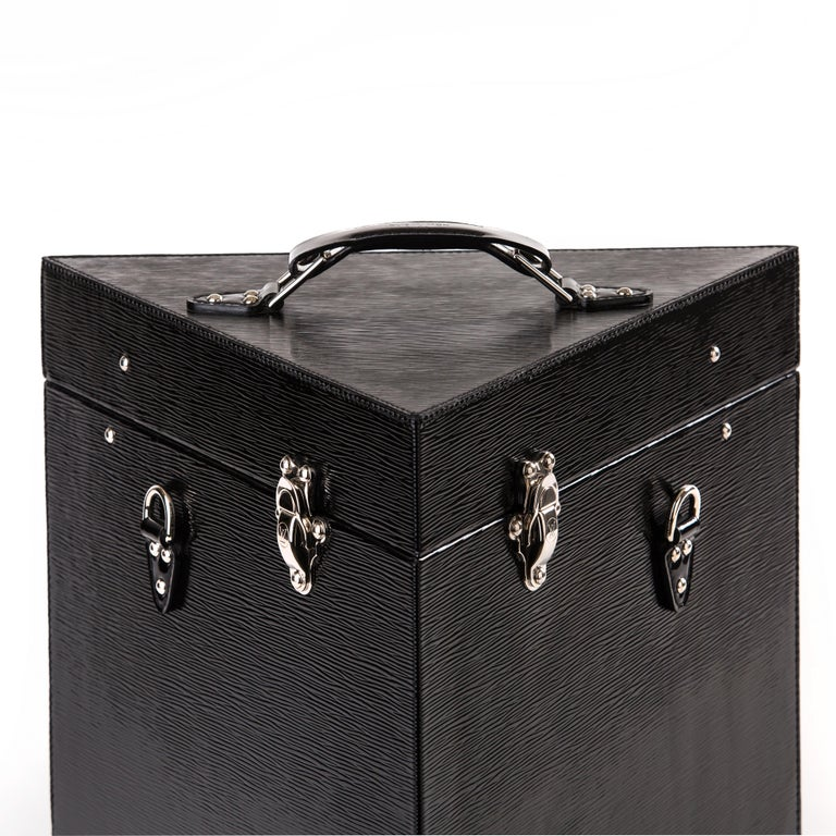 One of a kind Louis Vuitton Epi leather wine case. This triangular shaped wine case holds 4 bottles of wine or champagne. It features silver hardware with two buckles to secure the lid. There is also an Epi leather strap which can be attached to