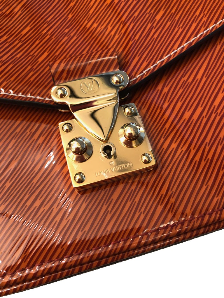 This lovely mini bag is made from LV patent Epi leather and LV Monogram canvas complete with a gold-tone chain shoulder strap.   Year: 2017 Material: Epi leather, LV Monogram canvas Color: Gold, beige/brown Hardware: Gold-tone Dimensions: L 20 cm x