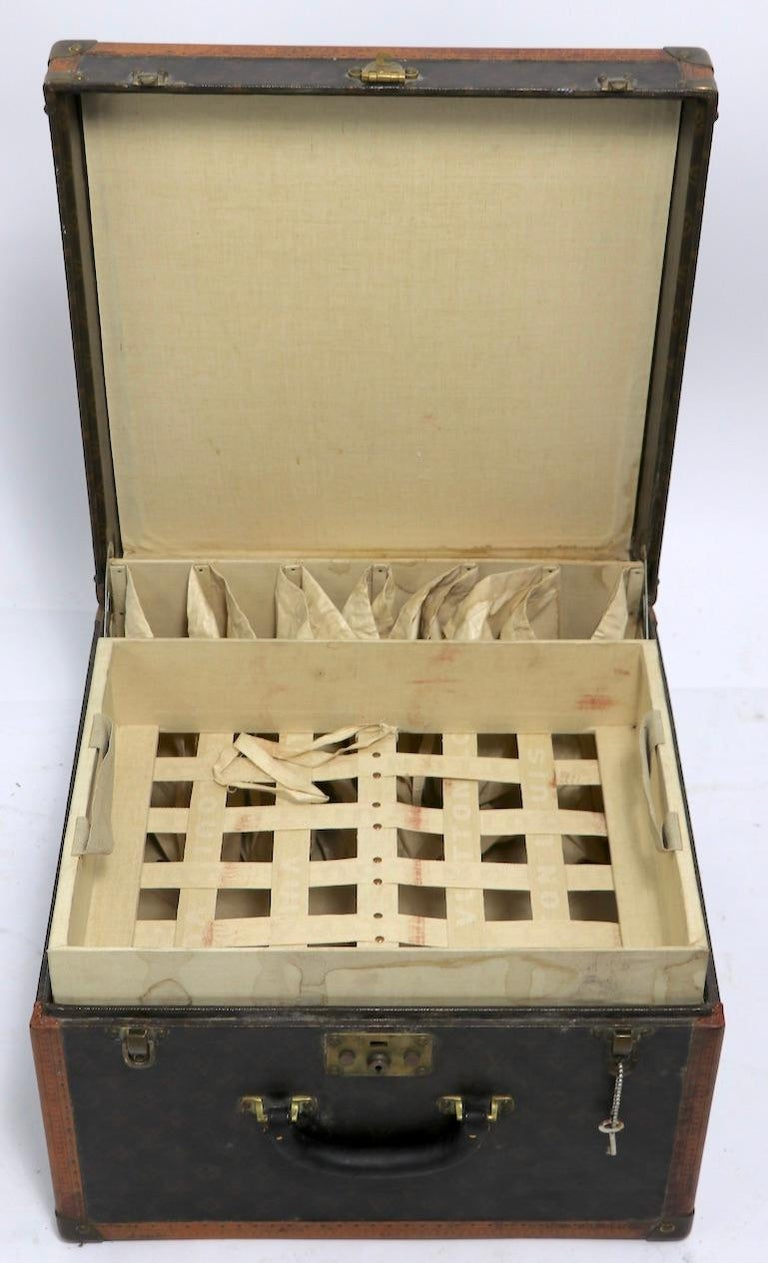 Chic and sophisticated antique Louis Vuitton overnight suitcase in good, original vintage condition. This example includes one key, and the removable interior sock tray, it shows expected cosmetic, normal and consistent with age. Signed and numbered