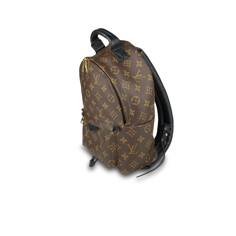 Brown and tan monogram coated canvas Louis Vuitton Palm Springs Backpack PM with  – Brass hardware – Single flat top handle – Dual adjustable flat shoulder straps – Black leather trim – Single exterior zip pouch, black nylon lining, single interior