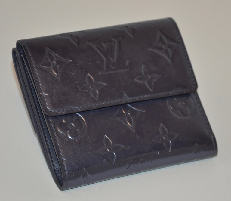 Louis Vuitton's pearl-steel signature monogram credit-card, billfold and change wallet measures 10 inches by 4 3/8 inches when opened. Measurement, when closed are 4 inches by 4 3/8 inches. Made in France.