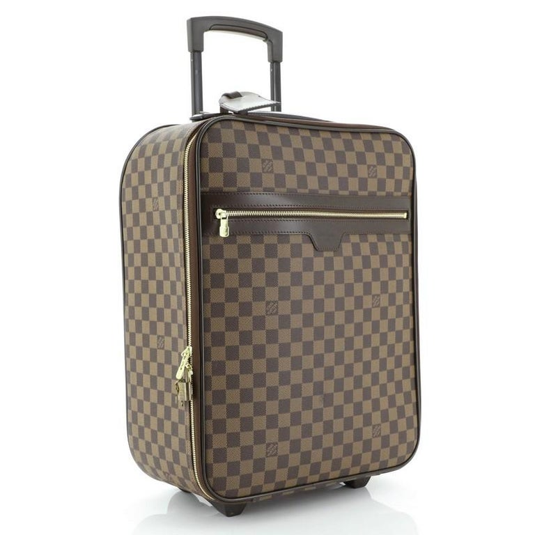 This Louis Vuitton Pegase Luggage Damier 45, crafted in damier ebene coated canvas, features exterior zip pocket, retractable handle with lock button, silent rolling system and gold-tone hardware. Its zip closure opens to a brown nylon and fabric