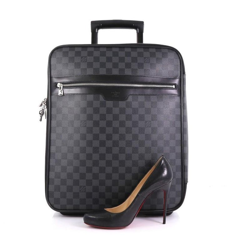 caf6174ce This Louis Vuitton Pegase Luggage Damier Graphite 45, crafted in damier  graphite coated canvas,