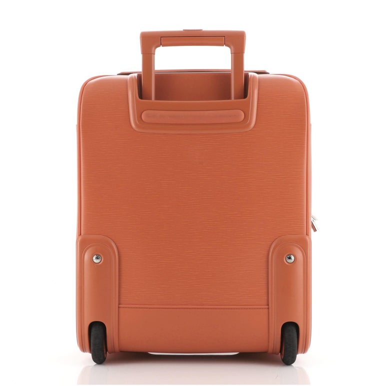 Louis Vuitton Pegase Luggage Orange Epi Leather 45 silver- tone hardware, one exterior zipper pocket, one exterior slip pocket, three interior zipper pocket and zipper closure.