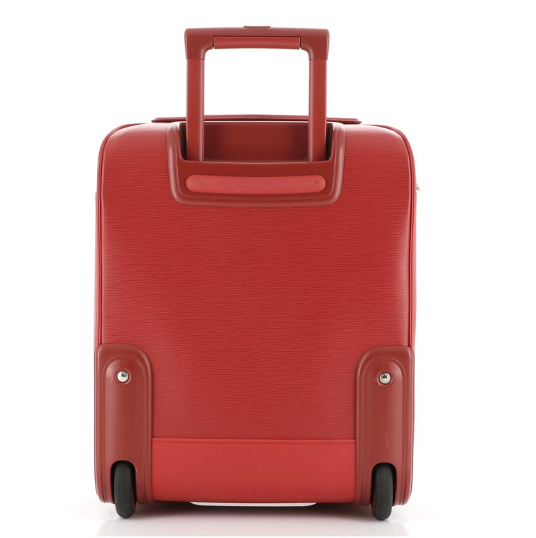 Louis Vuitton Pegase Luggage Red Epi Leather 45 with silver- tone hardware, one exterior zipper pocket, one exterior slip pocket, three interior zipper pocket and zipper closure.  Height 18
