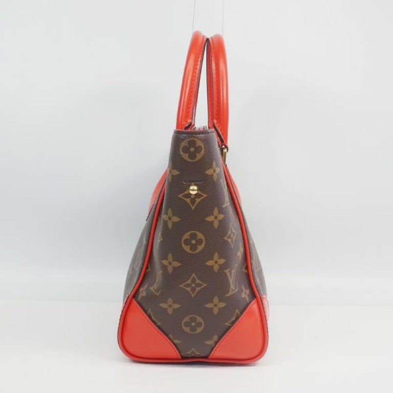 An authentic LOUIS VUITTON Phoenix PM 2way shoulder bag Womens handbag M41537 Cocrico. The color is Cocrico. The outside material is Monogram canvas. The pattern is PhoenixPM 2way  shoulder bag. This item is Contemporary. The year of manufacture