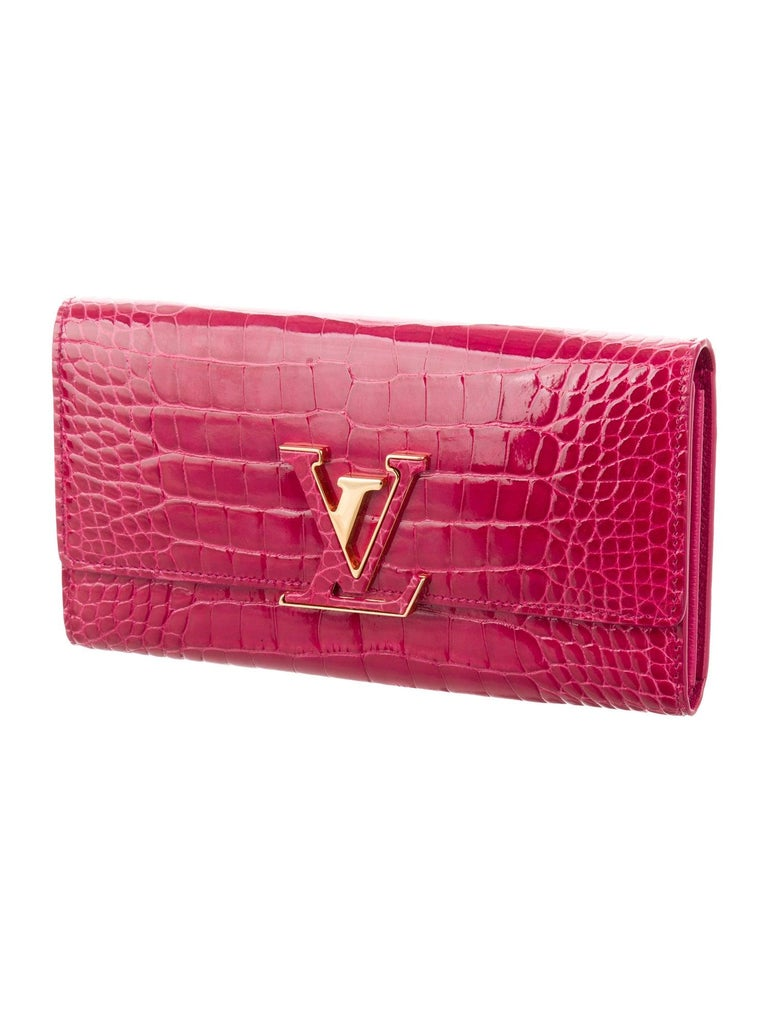 Louis Vuitton Pink Crocodile Exotic Leather Logo Charm Evening Clutch Wallet In Good Condition For Sale In Chicago, IL