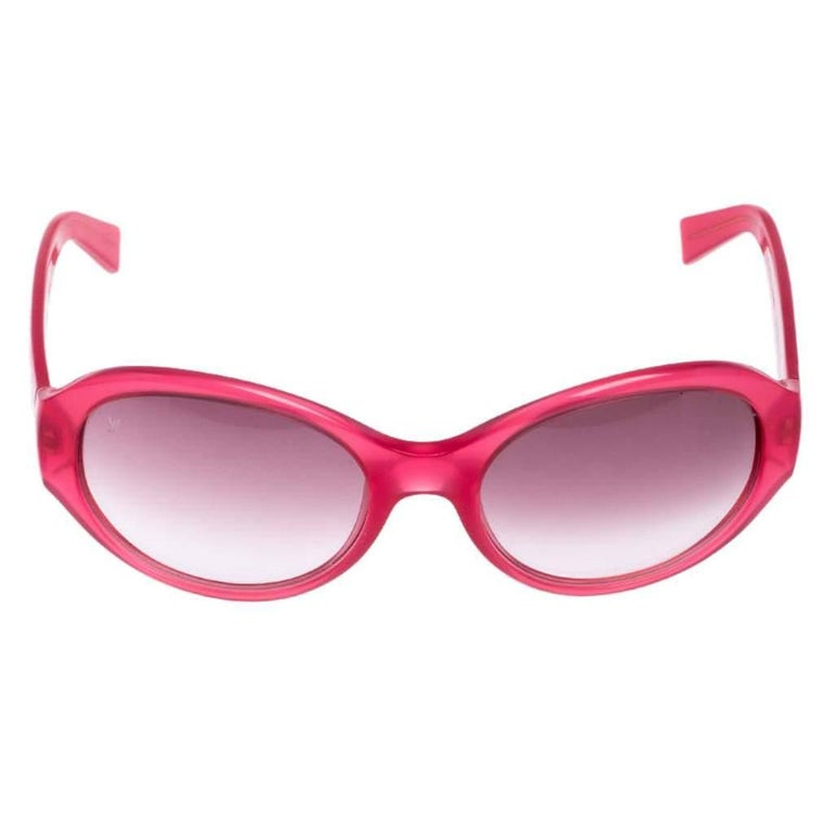 This pair of sunglasses from Louis Vuitton is in tune with the high-end, effortless style the brand is known for. The pink gradient lenses come enclosed in an oval frame with signature monogram detailing on the temples.  Includes: The Luxury Closet