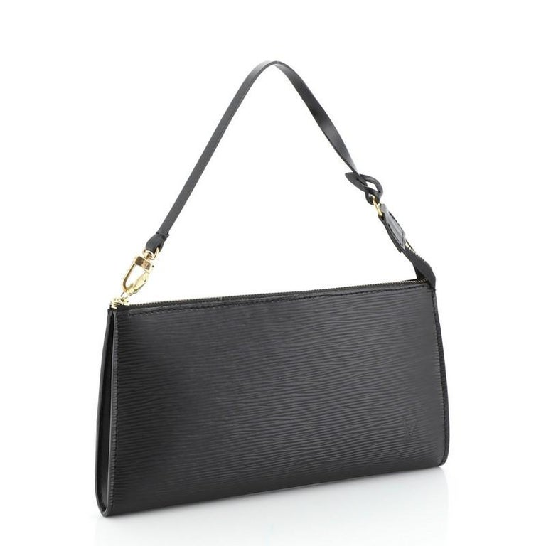 This Louis Vuitton Pochette Accessoires Epi Leather, crafted from black epi leather, features a flat leather strap and gold-tone hardware. Its zip closure opens to a gray microfiber interior with slip pocket. Authenticity code reads: AR0967.