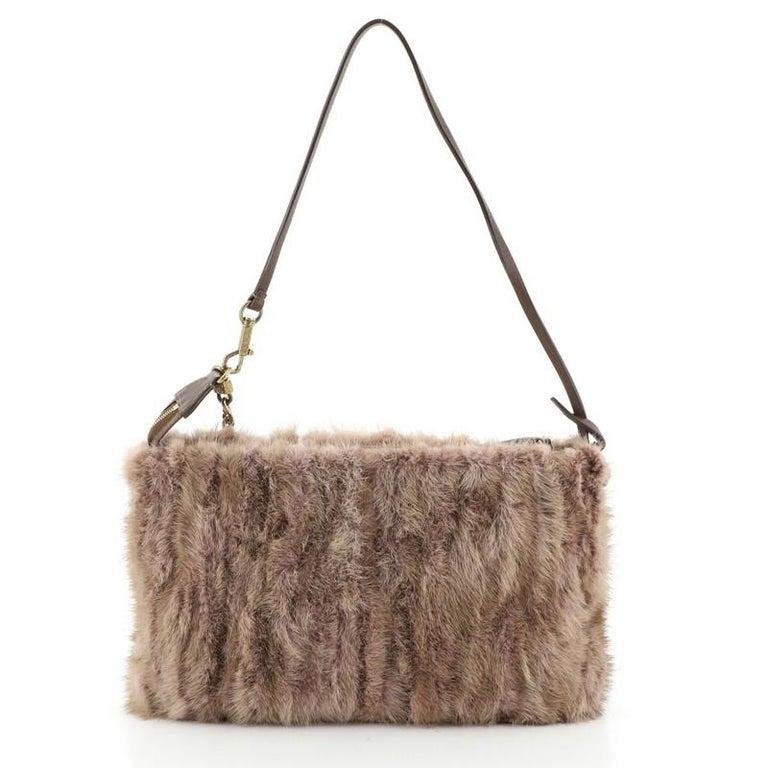 Women's or Men's Louis Vuitton Pochette Accessoires Limited Edition Caresse Mink For Sale