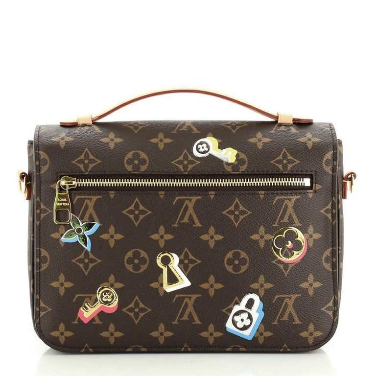 Louis Vuitton Pochette Metis Limited Edition Love Lock Monogram Canvas In Good Condition In New York, NY