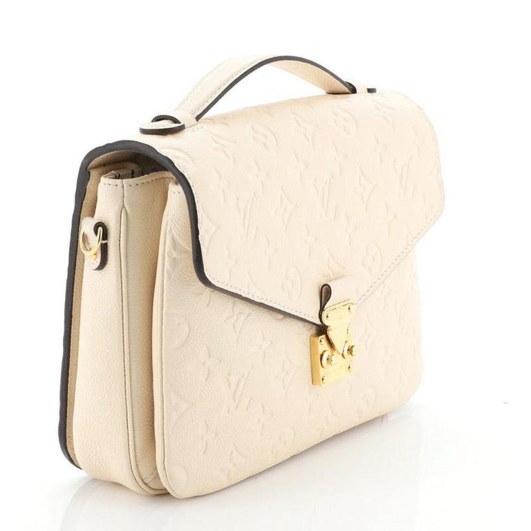 Beige Louis Vuitton Pochette Metis Monogram Empreinte Leather For Sale