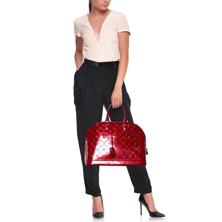 Out of all the irresistible handbags from Louis Vuitton, the Alma is the most structured one. First introduced in 1934 by Gaston-Louis Vuitton, the Alma is a classic that has received love from icons. This piece comes crafted from Monogram Vernis,