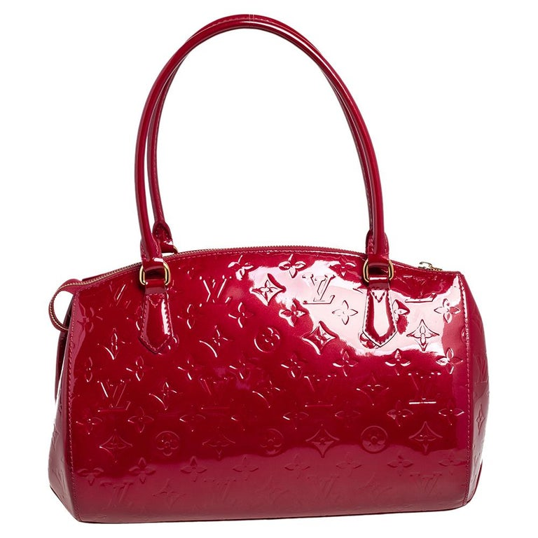 Louis Vuitton's handbags are popular owing to their high style and functionality. Crafted from beautiful red monogram Vernis, the Montana bag features dual top handles, lovely monogram charms, and gold-tone hardware. The zip-top closure opens to a