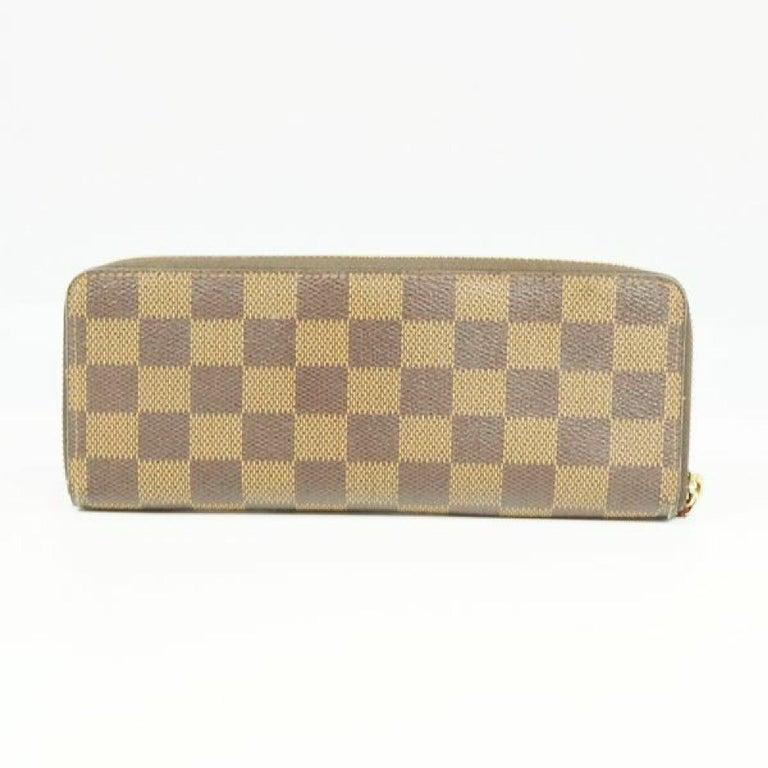An authentic LOUIS VUITTON portofeuilles Clemence Womens long wallet N60534 cerise. The color is cerise. The outside material is Damier canvas. The pattern is portofeuilles  Clemence. This item is Contemporary. The year of manufacture would be