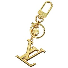 LOUIS VUITTON poruto Cle LV facet charm unisex key holder M65216 gold