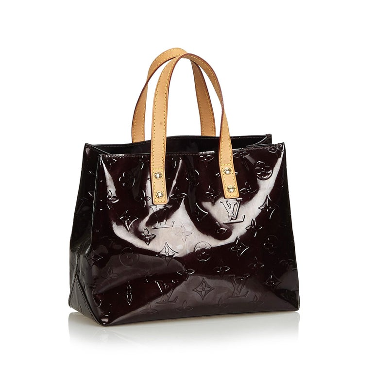 The Reade PM features a vernis leather body, flat handles, an open top, and an interior zip pocket. It carries as AB condition rating.  Inclusions:  This item does not come with inclusions.   Louis Vuitton pieces do not come with an authenticity
