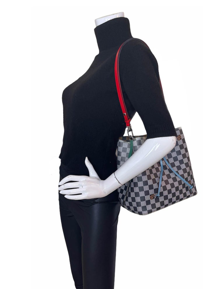 Louis Vuitton Limited Edition Nicolas Ghesquiere Black & White Damier Canvas NeoNoe Bag  Made In: France Year of Production: 2019 Color: Black and white with blue, green, and red leather accents Hardware: Materials: Coated canvas, leather Lining: