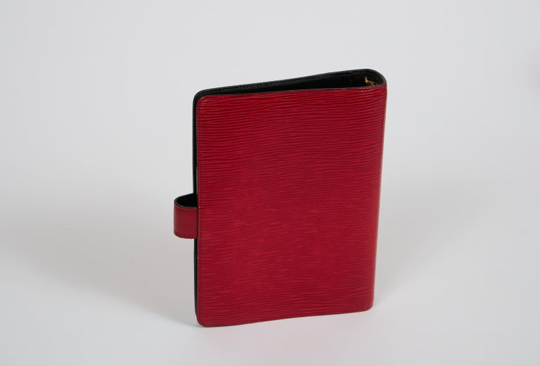 Louis Vuitton red epi leather planner/agenda cover with 6 rings.
