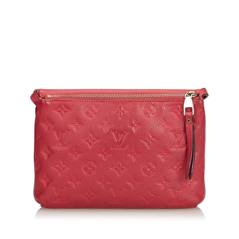 The Empreinte Twice Bag features an embossed leather body, a back zip compartment, a flat leather strap, a front flap, and an interior compartment. It carries as B condition rating.  Inclusions:  Dust Bag   Louis Vuitton pieces do not come with an