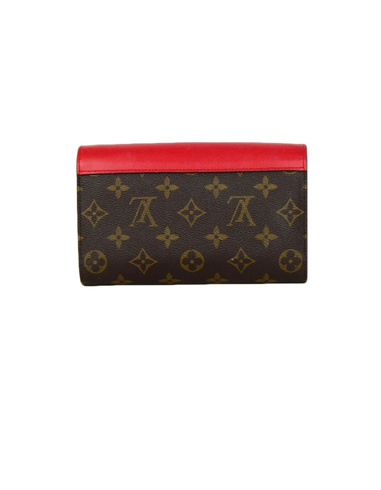 Louis Vuitton Red Monogram Leather Tribal Mask Wallet In Excellent Condition For Sale In New York, NY