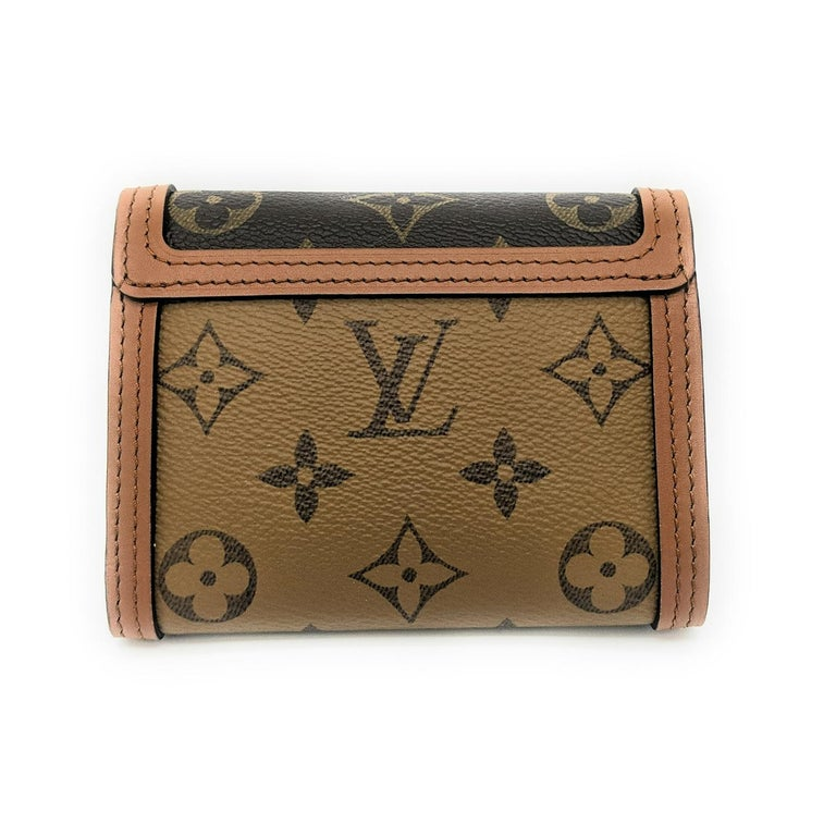 The Dauphine compact wallet takes its style cues from the emblematic Dauphine handbag. Its finely crafted design combines Monogram and Monogram Reverse canvas with calfskin trim, while it is secured by a magnetic Dauphine-signature clasp. This