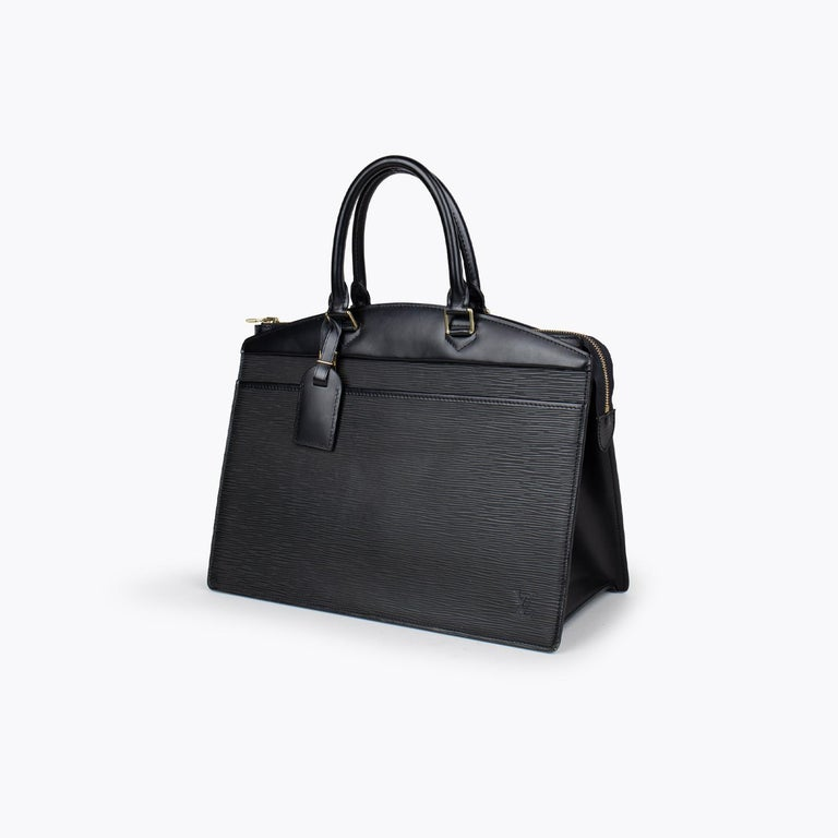 Black Epi leather Louis Vuitton Riviera bag with  - Brass Hardware - Dual rolled top handles - Embossed logo detail at corner - Single exterior pocket, grey coated lining, four interior pockets, five elastic cosmetic straps at interior and zip