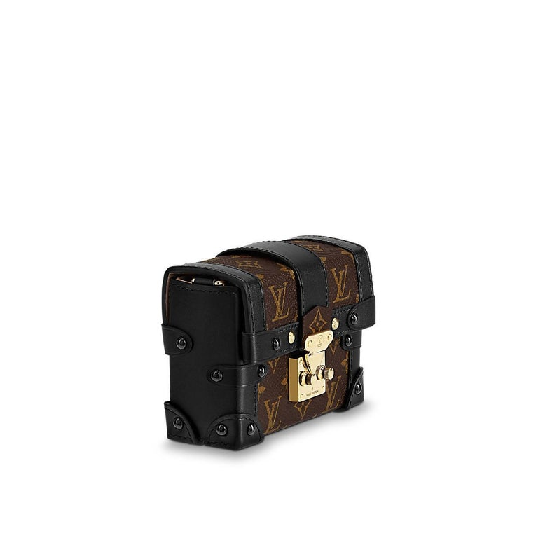 A miniature version of Louis Vuitton's iconic Petite Malle, replicating key details of the historic trunks, the Essential Trunk is the most elegant way to carry a few precious essentials. Its removable chain offers different carry options, while it