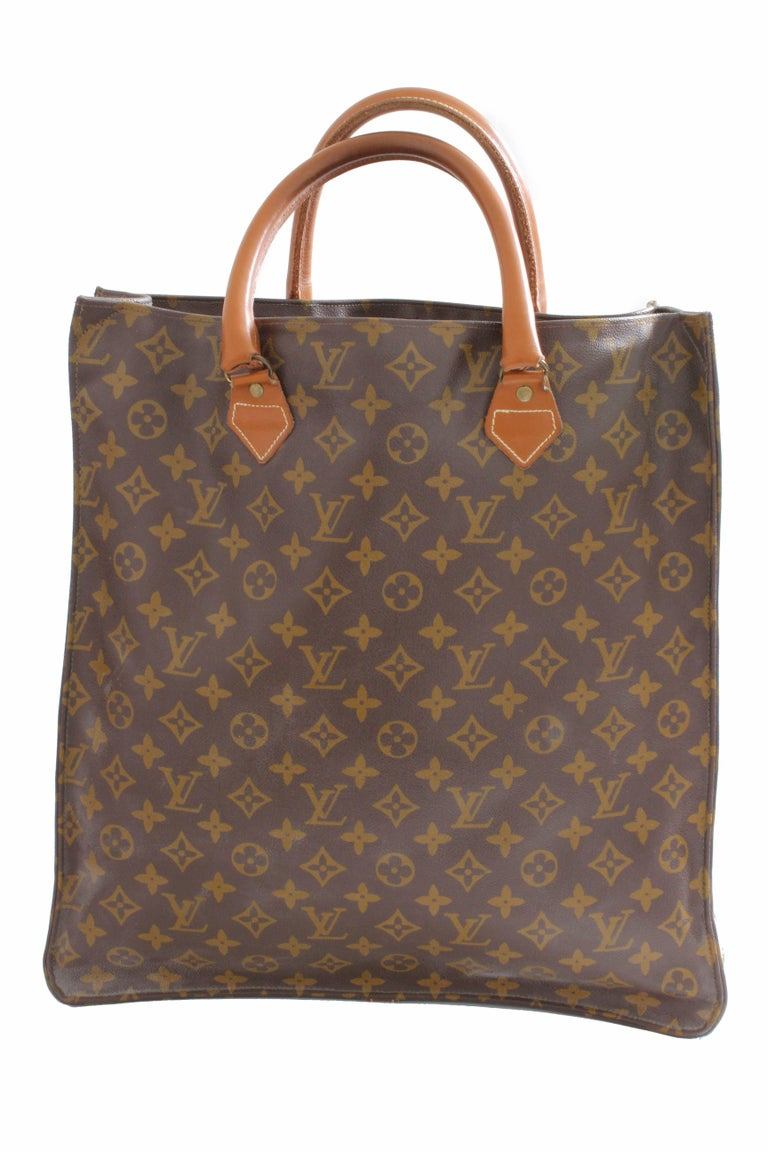 This vintage Sac Plat bag was made by The French Company under special license by Louis Vuitton, likely in the late 1970s.  If you know LV history, then you're most likely aware that LV partnered with The French Company from the 70s through the late