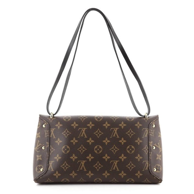 Louis Vuitton Sac Triangle Handbag Monogram Canvas PM In Good Condition For Sale In New York, NY