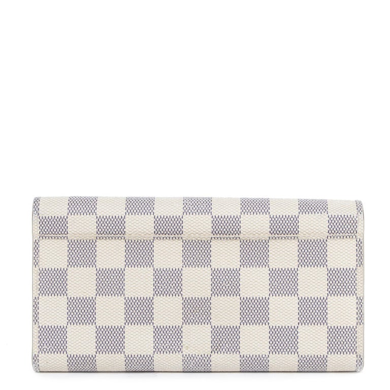 Very good condition  Louis Vuitton Sarah Damier Azur Wallet  Keep your most important items organised with this stylish Sarah wallet by Louis Vuitton. This long wallet is made from Damier canvas and features cowhide leather lining. The wallet opens