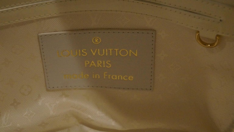 Louis Vuitton set x 2 Limited Edition White Braided Street Shopper Bags. This rare and discontinued canvas tote features gold and white woven leather with patent leather trim.  The exterior leather is clean and beautiful. The interior is clean and